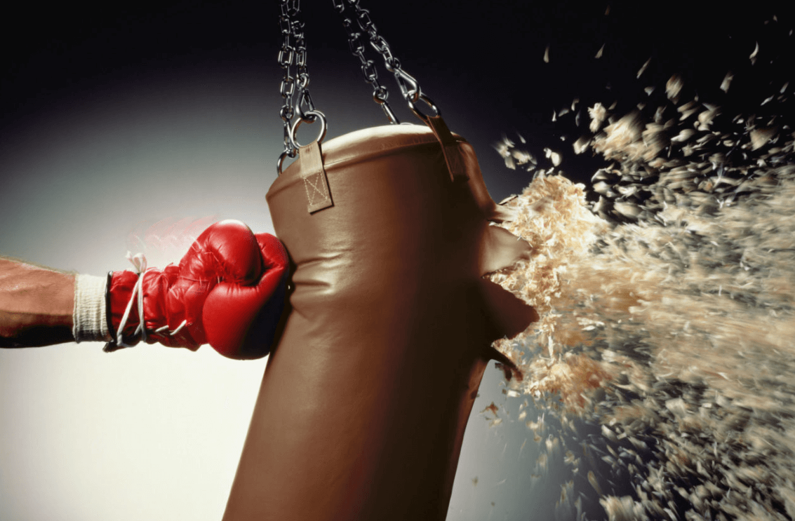 a punching bag being destroyed by a powerful punch